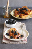 French toast with honey and fresh blackberries Royalty Free Stock Image