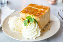 French toast with ice cream and almond.Honey toast with ice cream Royalty Free Stock Photos
