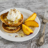 French toast with ice cream and honey on a white plate Royalty Free Stock Photo