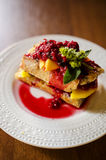 French toast with mango and raspberries Stock Photos