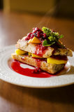 French toast with mango and raspberries Stock Image