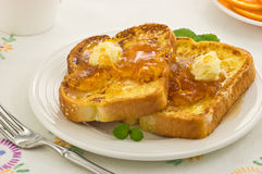 French Toast with Marmalade. Freshly cooked French Toast with warm Marmalade and whipped butter Royalty Free Stock Image