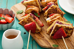 French toast pieces on a skewer with strawberry Stock Photos