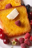French toast and raspberries and currants macro vertical top vie. French toast and raspberries and currants macro on a plate. vertical top view Stock Photo
