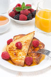French toast with raspberries and honey for breakfast Stock Photography