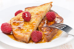 French toast with raspberries and honey, close-up Royalty Free Stock Photography