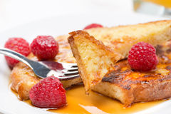 French toast with raspberries and maple syrup Royalty Free Stock Images