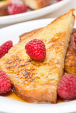 French toast with raspberries and maple syrup Stock Photography