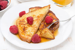 French toast with raspberries and maple syrup, top view Royalty Free Stock Photos