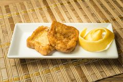 French toast in a rectangular dish on a bamboo mat Royalty Free Stock Photography