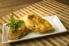 French toast in a rectangular dish on a bamboo mat Royalty Free Stock Photo
