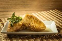 French toast in a rectangular dish on a bamboo mat Stock Photography