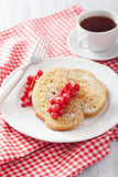 French toast with redcurrant and powder sugar for breakfast Stock Photo