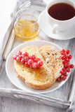French toast with redcurrant and powder sugar for breakfast Royalty Free Stock Photo