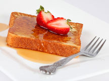 French toast and strawberries. French toast and syrup with strawberries isolated on white with fork Royalty Free Stock Image