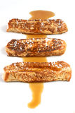 French Toast Strips. With maple syrup and powdered sugar; white background Stock Photography