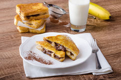 French toast stuffed with chocolate and banana Stock Photos