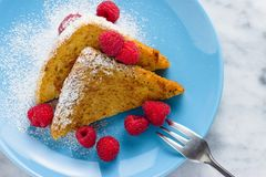French toast with sugar and raspberries stock photography