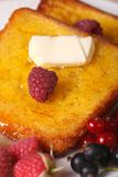 French toast with syrup and fresh berries macro on a plate. vert Royalty Free Stock Photos