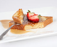 French toast with syrup and strawberry. On a white plate Stock Image