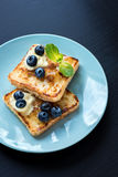 French toast. S with fresh blueberries and maple syrup. Healthy breakfast concept Royalty Free Stock Photo