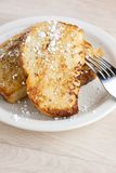 French Toast. On a white plate sitting on a wooden background Stock Photos