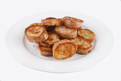 French Toasts. Close up shot of brown toasts on a white plate Stock Photos