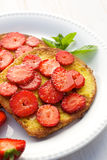 French toasts with addition of fresh strawberries on white plate Stock Image
