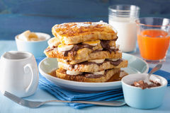 French toasts with banana chocolate sauce and caramel for breakf Stock Photos