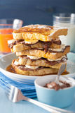 French toasts with banana chocolate sauce and caramel for breakf Stock Images