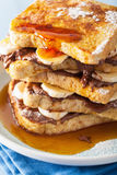 French toasts with banana chocolate sauce and caramel for breakf Stock Photo