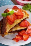 French toasts with chocolate spread and strawberry Stock Images