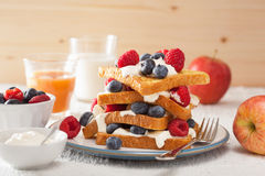 French toasts with creme fraiche and berries for breakfast Royalty Free Stock Photos
