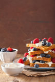 French toasts with creme fraiche and berries for breakfast Stock Images