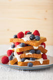 French toasts with creme fraiche and berries for breakfast Royalty Free Stock Photography