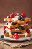 French toasts with creme fraiche and berries for breakfast Stock Photography