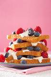French toasts with creme fraiche and berries for breakfast Stock Photo