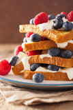 French toasts with creme fraiche and berries for breakfast Royalty Free Stock Photo
