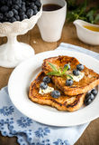 French toasts with fresh blueberries and maple syrup Stock Images