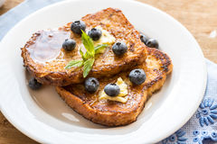 French toasts with fresh blueberries and maple syrup Royalty Free Stock Photos