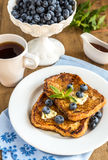 French toasts with fresh blueberries and maple syrup Royalty Free Stock Photography