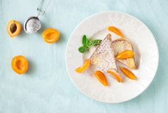 French toasts with fresh cut apricot. Health breakfast concept. French toasts with fresh cut apricot. Health classic breakfast concept royalty free stock image