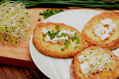 French toasts with goats cheese, fresh chives and sprouts. Stock Photography