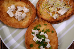 French toasts with goats cheese, fresh chives and sprouts. Royalty Free Stock Image