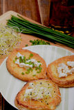 French toasts with goats cheese, fresh chives and sprouts. Stock Image