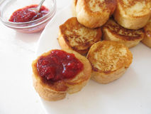 French toasts with jam. French toasts with strawberry jam stock image