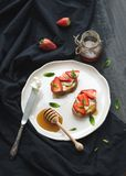 French toasts with strawberry, cream cheese, honey Royalty Free Stock Images