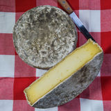 French tomme cheese for sale on a market stall Royalty Free Stock Photos