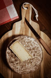 French tomme cheese for sale on a market stall Stock Photo