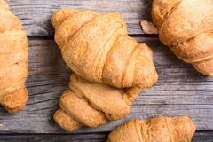 French traditional breakfast croissant. On wooden background Royalty Free Stock Photos